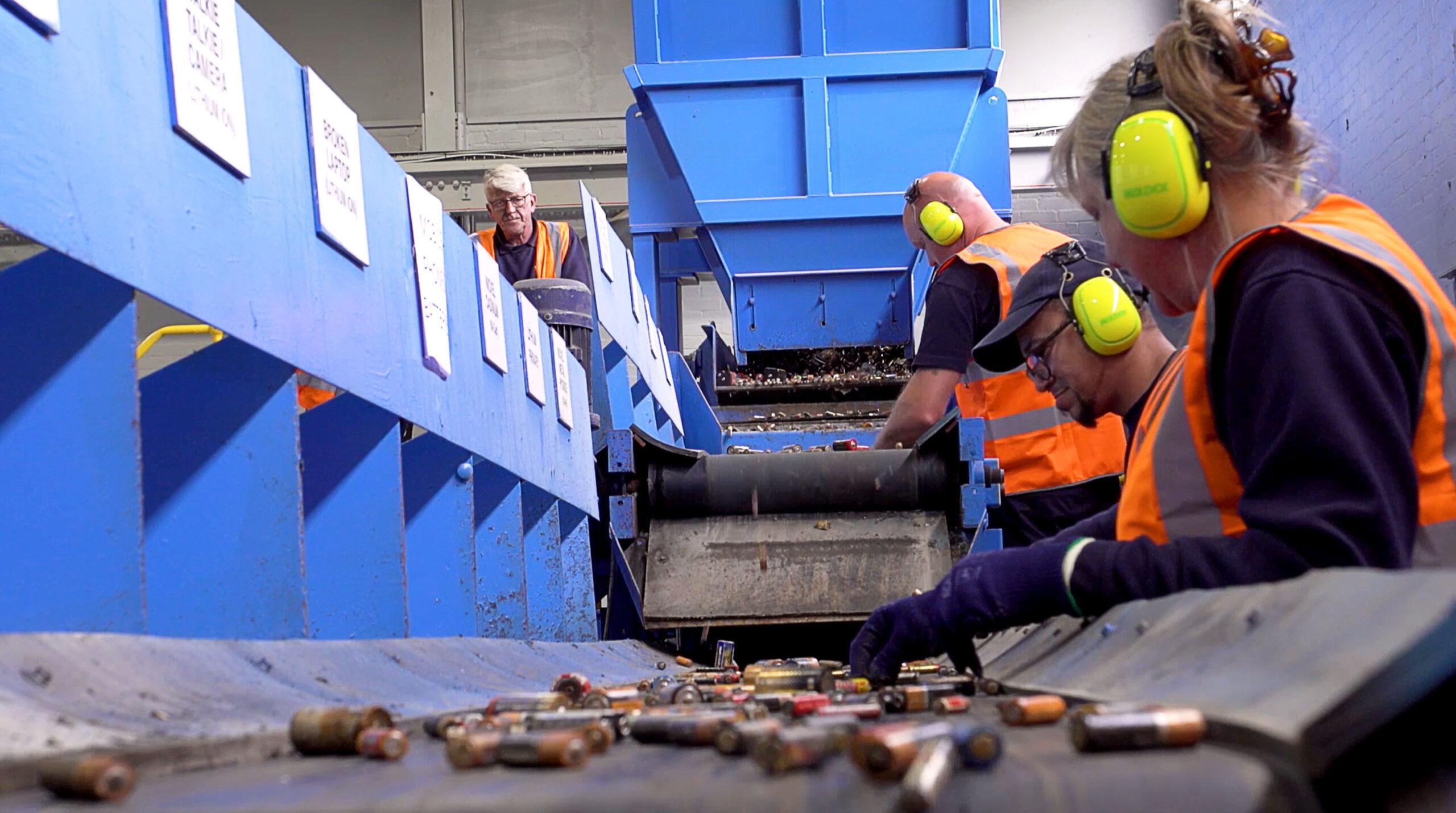 people sorting batteries